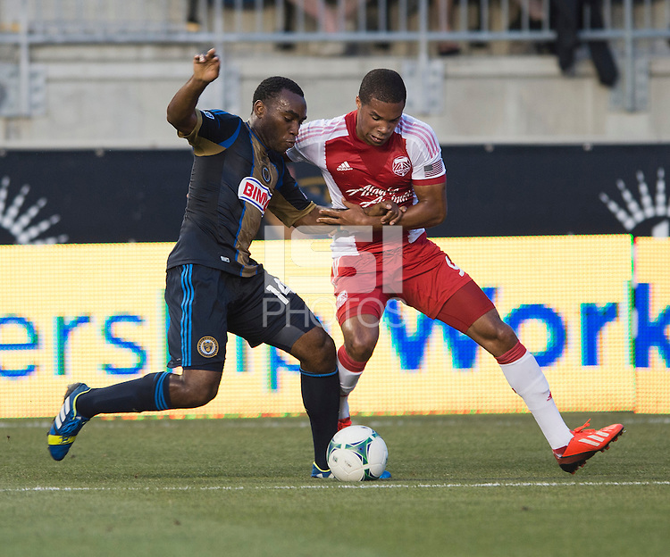 Amobi Okugo (14) of the Philadelphia Union fights for the ball with Ryan Johnson (9) of the Portland Timbers during a Major League Soccer game at PPL Park in Chester, PA.  Philadelphia Union tied the Portland Timbers, 0-0.
