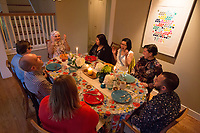 "SEATTLE, WA-APRIL 17, 2017:  (going from Amanda right and clockwise) Lots of laughter ensued during the dinner party with Amanda Saab, center, Anjana Agarwal, Charissa Pomrehn, Patricia Rangel, Hussein Saab, Stefanie Fox, Greg Pomrehn and Nason Fox. <br /> <br /> Amanda Saab, along with her husband Hussein Saab, host a ""dinner with your Muslim neighbor"" at the home of Stefanie and Nason (cq) Fox in Seattle, WA on a return trip April 17th 2017. The couple now live in Detroit. (Photo by Meryl Schenker/For The Washington Post)"