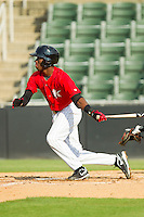 Tim Anderson (2) of the Kannapolis Intimidators follows through on his swing against the Greenville Drive at CMC-Northeast Stadium on June 29, 2013 in Kannapolis, North Carolina.  The Intimidators defeated the Drive 9-3 in the completion of the game that began on June 28, 2013.   (Brian Westerholt/Four Seam Images)