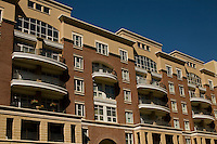 Condos are shown on a sunny day in uptown Charlotte, NC.
