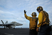 "080923-N-7981E-119 Pacific Ocean (September 23, 2008)- An aircraft director supervises an under instruction trainee as he directs an F/A-18F Super Hornet assigned to ""Bounty Hunters"" of Strike Fighter Squadron (VFA) 2 on the flight deck of USS Abraham Lincoln (CVN 72). The USS Abraham Lincoln Strike Group is on a scheduled deployment in the U.S. 7th Fleet area of responsibility.  Operating in the Western Pacific and Indian Ocean, the U.S. 7th Fleet is the largest of the forward-deployed U.S. fleets covering 52 million square miles, with approximately 60-70 ships, 200-300 aircraft and 40,000 Sailors and Marines assigned at any given time.  U.S. Navy photo by Mass Communication Specialist 2nd Class James R. Evans (RELEASED)"