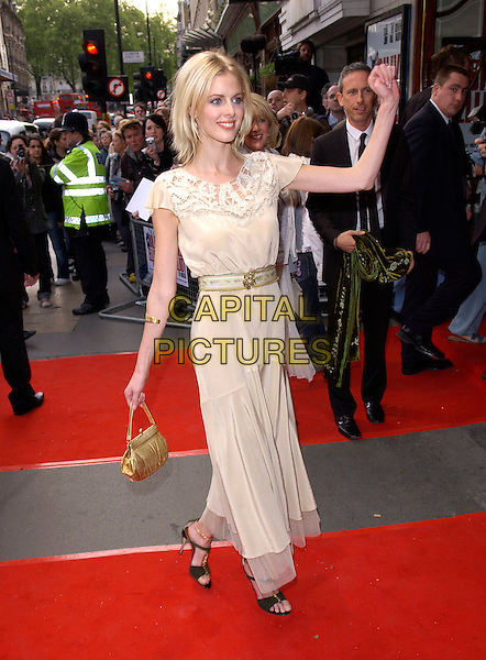 DONNA AIR.Attends the opening night and World Premiere of Billy Elliot the Musical, at the Victoria Palace theatre, London, May 12th 2005..full length cream gold dress gold bag shoes skinny thin belt waist waving funny.Ref: DH.www.capitalpictures.com.sales@capitalpictures.com.©David Hitchens/Capital Pictures.