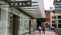 NEW YORK, NY - AUGUST 31: People are seen near the TESLA store on August 31, 2020 in New York City. Tesla shares are more affordable today after their split, which does not make the stock a more attractive investment than it was pre-split price. (Photo by Eduardo MunozAlvarez/VIEWpress)