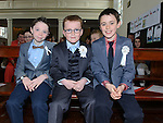 Shaun Fairley, Charlie Murphy and Craig Callanan who received first holy communion at the church of SS Peter and Paul Walshestown. Photo:Colin Bell/pressphotos.ie