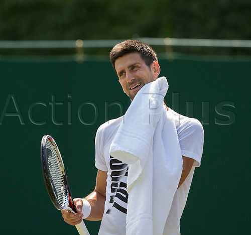 July 6th 2017, All England Lawn Tennis and Croquet Club, London, England; The Wimbledon Tennis Championships, Day 4; Novak Djokovic (SRB) wiping down his face with a towel during practice on court