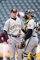 Garrett Brummett #26 of the Wichita State Shockers talks with Parker Zimmerman #35 of the Wichita State Shockers on the mound during a game against the Missouri State Bears at Hammons Field on May 5, 2013 in Springfield, Missouri. (David Welker/Four Seam Images)