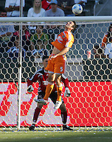 Houston Dynamo defender Ryan Cochrane (5) leaps high for a head ball as Dynamo goalkeeper Pat Onstad (18) looks on. The Houston Dynamo defeated the LA Galaxy 3-1 at the Home Depot Center in Carson, CA, Sunday, September 16, 2007.
