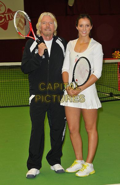Sir Richard Branson & Laura Robson.Press conference & photocall where British tennis star, Laura Robson, becomes Virgin Active's first tennis ambassador & the face of Virgin Active's Junior Tennis Academy, Virgin Active Chiswick Riverside, London, England..February 26th, 2013.full length black tracksuit white skirt racquets  goatee facial hair .CAP/WIZ.© Wizard/Capital Pictures.