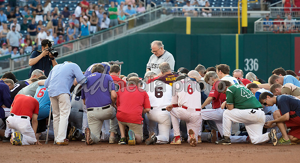 United States House Chaplain, Father Patrick J. Conroy, S.J. leads both teams in prayer prior to the 56th Annual Congressional Baseball Game for Charity where the Democrats play the Republicans in a friendly game of baseball at Nationals Park in Washington, DC on Thursday, June 15, 2017. Photo Credit: Ron Sachs/CNP/AdMedia