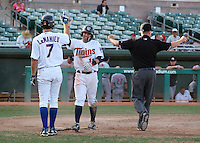 Mesa Solar Sox second baseman Brian Dozier #11 is congratulated by D.J. LeMahieu #7 after scoring the game winning run during an Arizona Fall League game against the Phoenix Desert Dogs at HoHoKam Park on November 3, 2011 in Mesa, Arizona.  Mesa defeated Phoenix 8-7.  (Mike Janes/Four Seam Images)