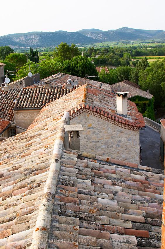 Chateau de Lascaux, Vacquieres village. Pic St Loup. Languedoc. Village roof tops with tiles.. Les Contreforts des Cevennes. France. Europe.