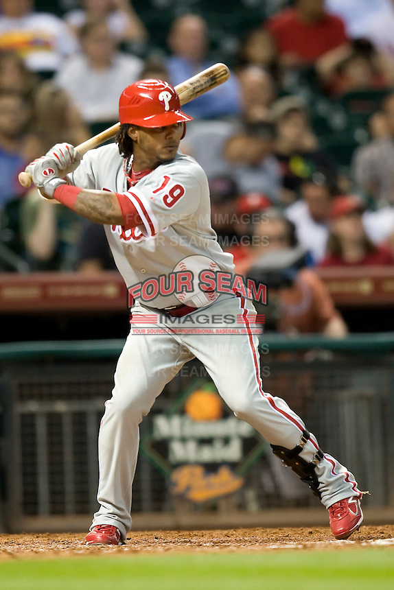 Philadelphia Phillies second baseman Michael Martinez #19 at bat during the Major League Baseball game against the Houston Astros at Minute Maid Park in Houston, Texas on September 13, 2011. Houston defeated Philadelphia 5-2.  (Andrew Woolley/Four Seam Images)