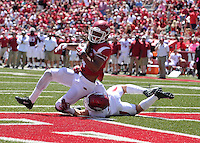 NWA Democrat-Gazette/Michael Woods --04/25/2015--w@NWAMICHAELW... University of Arkansas receiver Keon Hatcher makes a touchdown catch in front of Reid Miller during the 2015 Red-White game Saturday afternoon at Razorback Stadium in Fayetteville.