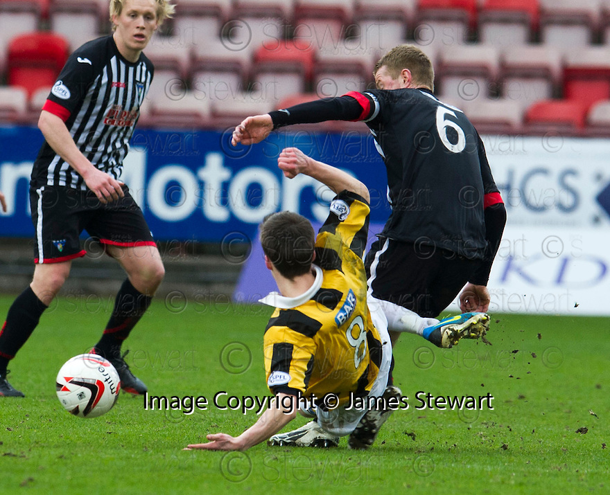 East Fife's Lewis Barr goes in late on Pars' Andrew Geggan,  was booked for his reaction after being fouled.