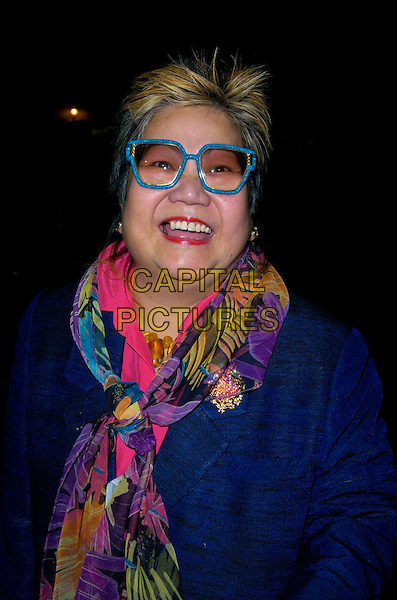 NANCY LAM.At the OK Celebrity Secrets Party at Studio Valbonne, London, UK..March 8th 2007.headshot portrait blue purse jacket scarf floral print turquoise glasses .AP/CAN.©Can Nguyen/Capital Pictures