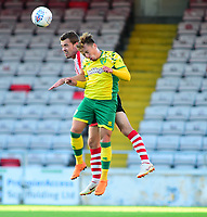 Lincoln City's  Harry Toffolo vies for possession with  Norwich City's Felix Passlack<br /> <br /> Photographer Andrew Vaughan/CameraSport<br /> <br /> Football Pre-Season Friendly - Lincoln City v Norwich City - Tuesday 10th July 2018 - Sincil Bank - Lincoln<br /> <br /> World Copyright &copy; 2018 CameraSport. All rights reserved. 43 Linden Ave. Countesthorpe. Leicester. England. LE8 5PG - Tel: +44 (0) 116 277 4147 - admin@camerasport.com - www.camerasport.com