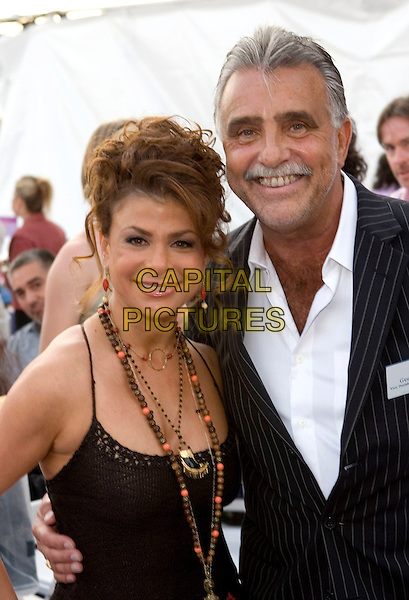 PAULA ABDUL & GUEST.LA Mart and cbk present the 4th annual American Foundation for AIDS Research (Amfar) fundraiser/street party entitled  'Takin' it to the Beach'  held at 1933 S. Broadway, Los Angeles, California..July 23rd, 2005.Photo Credit: Zach Lipp/AdMedia.half length beaded neckalces black crochet top.www.capitalpictures.com.sales@capitalpictures.com.© Capital Pictures.