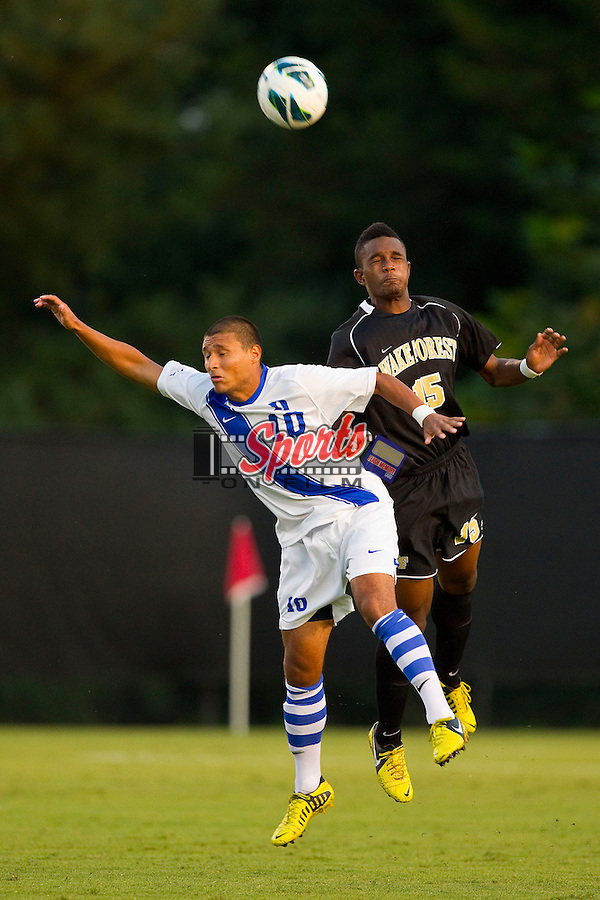 Jalen Robinson (15) of the Wake Forest Demon Deacons battles for a jump ball with Luis Rendon (10) of the Duke Blue Devils at Spry Soccer Stadium on September 21, 2012 in Winston-Salem, North Carolina.  The Demon Deacons and the Blue Devils battled to a 0-0 tie in 2 overtimes.  (Brian Westerholt/Sports On Film)