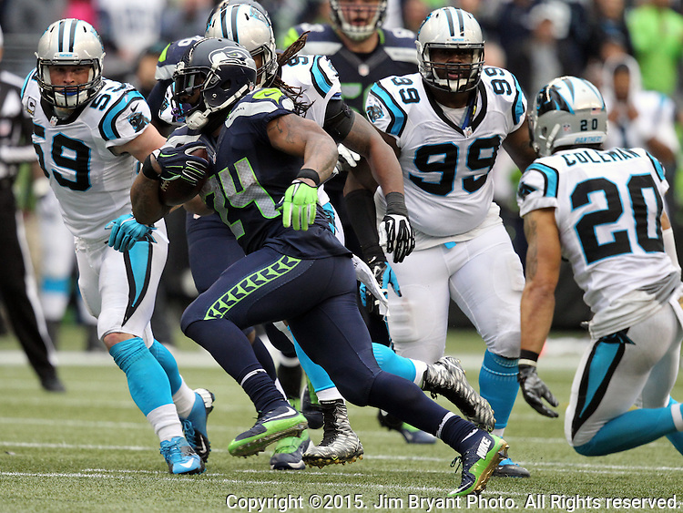 Seattle Seahawks  running back Marshawn Lynch (24) slips by Carolina Panthers defensive end Ryan Delaire (91) and safety Kurt Coleman (20) at CenturyLink Field in Seattle on October 18, 2015. The Panthers came from behind with 32 seconds remaining in the 4th Quarter to beat the Seahawks 27-23.  ©2015 Jim Bryant Photography. All Rights Reserved.