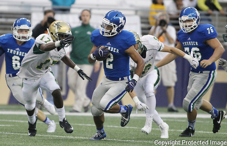 Mountain View running back Preston Jones (2) breaks tackles as the rushes for 120 yards on 18 carries against Auburn in  2015 Emerald City Kickoff Classic at Husky Stadium.  The Thunder beat the Trojans 32-21. Jim Bryant for The Columbian.