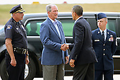 United States President Barack Obama (2nd R) is greeted by (L-R) Aurora Police Chief Dan Oats, Aurora Mayor Steve Hogan and 460th Space Wing Command Chief William Ward after arriving at Buckley Air Force Base July 22, 2012 in Aurora, Colorado. Obama traveled to the University of Colorado Hosptial to meet with victims of last Friday's movie theater mass shooting. Police in Aurora, a suburb of Denver, say that James Holmes, 24, in custody after he is suspected of killing 12 people and injuring 59 during a midnight screening of 'The Dark Knight Rises' last Friday. .Credit: Chip Somodevilla / Pool via CNP
