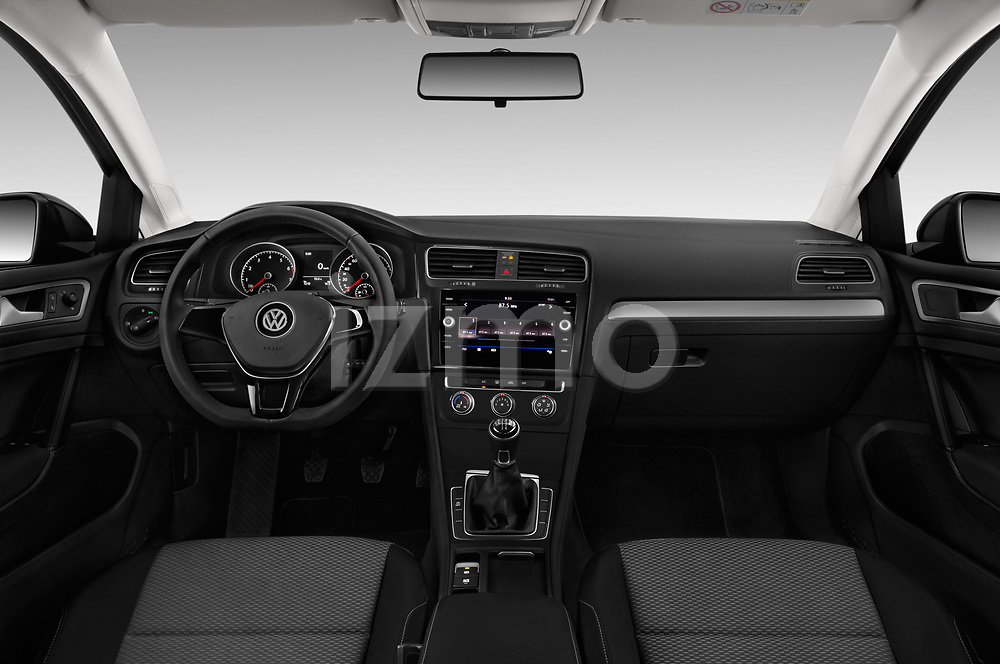 Stock photo of straight dashboard view of a 2017 Volkswagen Golf Trendline 3 Door Hatchback