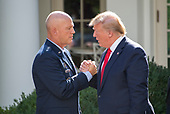 "United States President Donald J. Trump, right, shakes hands with General John W. ""Jay"" Raymond, Commander, Air Force Space Command, left, as he announces he is establishing the US Space Command in the Rose Garden of the White House in Washington, DC on Thursday, August 29, 2019.  The Space Command will be the lead military agency for the planning and execution of space operations and will be a step towards establishing a Space Force as a new military service. <br /> Credit: Ron Sachs / Pool via CNP"