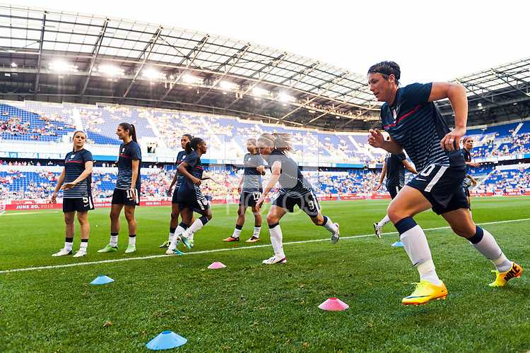 United States (USA) midfielder Heather O'Reilly (9) and forward Abby Wambach (20)  during warmups prior to playing the Korea Republic (KOR). The women's national team of the United States defeated the Korea Republic 5-0 during an international friendly at Red Bull Arena in Harrison, NJ, on June 20, 2013.