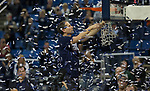 Nevada head coach Eric Musselman cuts down the net after their win over Colorado State for the Mountain West Championship in a NCAA college basketball game in Reno, Nev., Sunday, Feb. 25, 2018. (AP Photo/Tom R. Smedes)