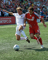 06 June2009: Los Angeles Galaxy midfielder Eddie Lewis #6 and Toronto FC defender Kevin Harmse #5 during MLS at BMO Field Toronto in a game between LA Galaxy and Toronto FC. .The Galaxy  won 2-1.