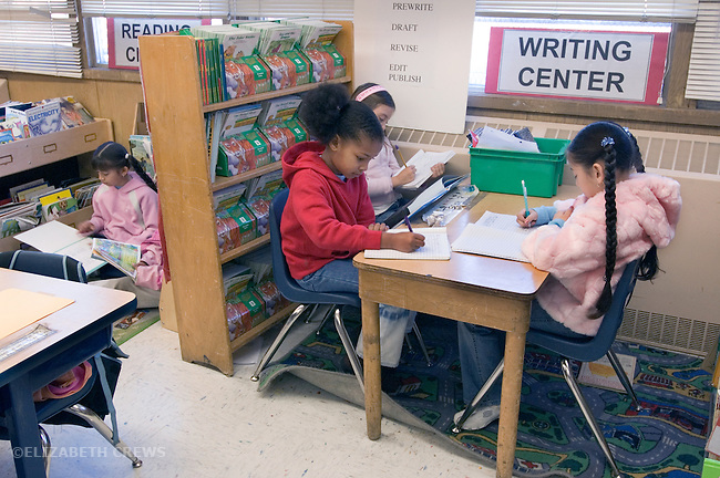 Oakland CA 2nd grade students working in Writing and Reading Centers in class