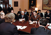 United States President Ronald Reagan meets with John Fisher, President, American Security Council and Executive Chairman, Coalition of Peace Through Strength, left, and other representatives of chief organizations in the coalition. The meeting took place in the Roosevelt Room in the White House in Washington, D.C. on Monday, March 7, 1983. .Mandatory Credit: Karl Schumacher - White House via CNP