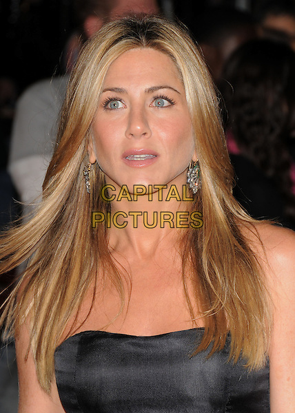"""JENNIFER ANISTON.The Twentieth Century Fox World Premiere of """"Marley & Me"""" held at The Mann Village Theatre in Westwood, California, USA. .December 11th, 2008 .headshot portrait earrings strapless .CAP/DVS.©Debbie VanStory/Capital Pictures."""