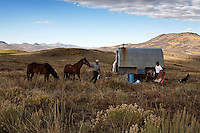 Peruvian shepherds live at camps and tend flocks of sheep in southern Wyoming.<br />