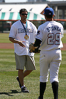 April 14, 2010:  Olympic Gold Medalist Steve Mesler delivers a ceremonial first pitch with Tobi Stoner before the opening home game vs. Pawtucket at Coca-Cola Field in Buffalo, New York.  The Bisons are the Triple-A International League affiliate of the New York Mets.  Photo By Mike Janes/Four Seam Images