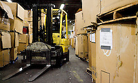 12/4/2008 3:51:53 PM -- Seattle, WA.A forklift navigates through stacks of boxes contain electronic compenents that have been broken down and those awaiting being broken down at Total Reclaim Inc., Environmental Services in Seattle Thursday Dec. 4, 2008.