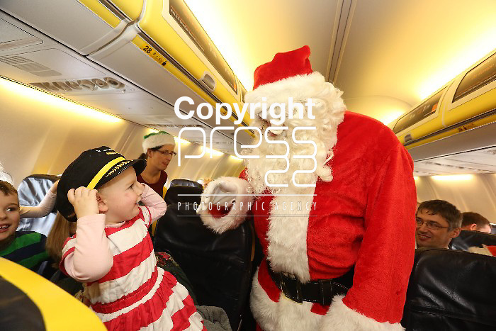 Free Pics    With Compliments Eve Ni Maunaigh age 1 pictured on board  the 11.40 Ryanair Santa Flight from Shannon Airport to see Santa on board to 40 minute flight on Sunday as Ryanair and Shannon Airport joined forces with Santa and his elves to offer free flights to the young and the young at heart to meet with the man himself as a thank you to the people of the midwest. Pic. Brian Arthur/ Press 22.