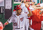 7 October 2016: Washington Nationals catcher and Baseball America top prospect Pedro Severino returns to the dugout after scoring in the 4th inning of the NLDS Game 1 against the Los Angeles Dodgers at Nationals Park in Washington, DC. The Dodgers edged out the Nationals 4-3 to take the opening game of their best-of-five series. Mandatory Credit: Ed Wolfstein Photo *** RAW (NEF) Image File Available ***