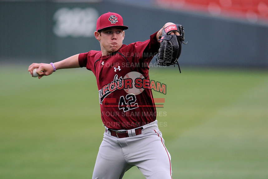 Pitcher Cody Mincey (42) of the South Carolina Gamecocks works out before a game against the Furman Paladins on Tuesday, April 8, 2014, at Fluor Field at the West End in Greenville, South Carolina. (Tom Priddy/Four Seam Images)