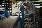 Kerri making apple juice from the Bramleys.   Tinker's Bubble, Low impact community,  Somerset