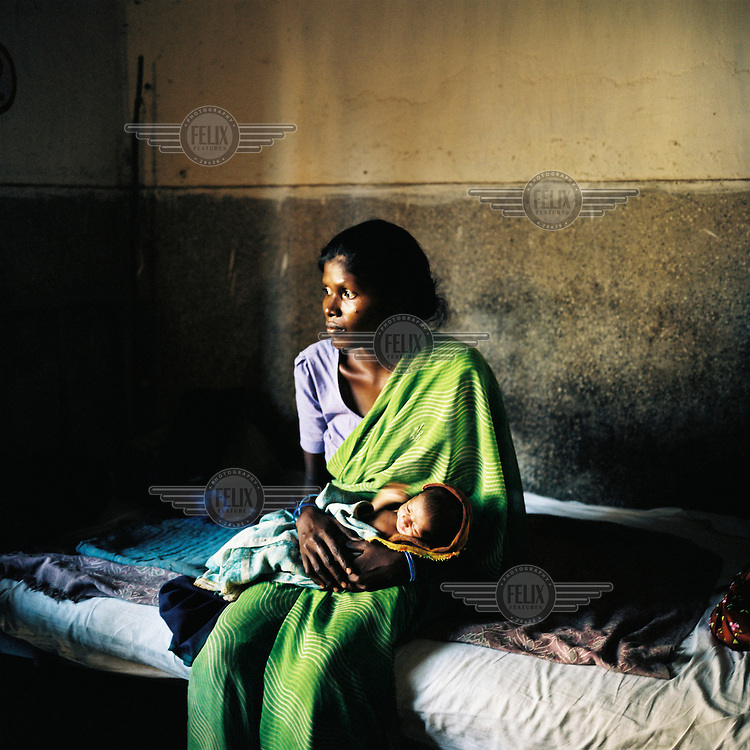 A woman and her newborn baby in a clinic in Orissa state.