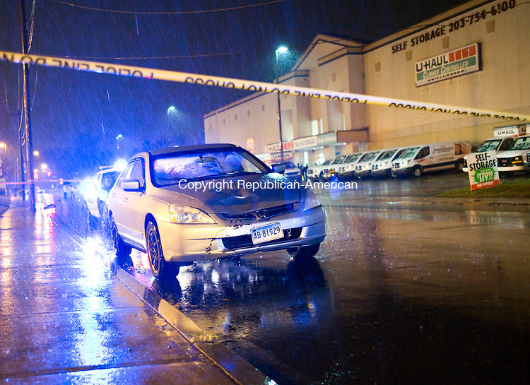 Waterbury, CT- 23 December 2015-122315CM14- A Honda Accord is seen parked along Bank Street in Waterbury on Wednesday evening.  Police say Theresa Coll, of Waterbury was killed as she was crossing Bank Street at around 4:50 p.m. on Wednesday.  Christopher Massa Republican-American