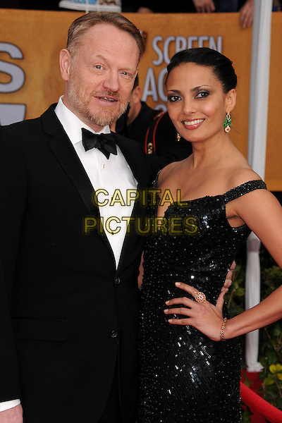 Jared Harris & Allegra Riggio.Arrivals at the 19th Annual Screen Actors Guild Awards at the Shrine Auditorium in Los Angeles, California, USA..27th January 2013.SAG SAGs half  length black tuxedo white shirt bow tie dress hand on hip off the shoulder couple sequins sequined .CAP/ADM/BP.©Byron Purvis/AdMedia/Capital Pictures