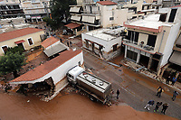 Pictured: The flood recedes revealing a damaged building.<br /> Re: Five people have reportedly died and severe damage caused by heavy rain and flash flooding in the area of Mandra, near Athens, Greece. Wednesday 15 November 2017