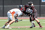 Orange, CA 05/02/10 - John Crowell (Biola # 15) and Andrew Hauke (CS Fullerton # 2) in action during the Biola-Cal State Fullerton MCLA SLC Division II final game in Wilson Field at Chapman University.  CS Fullerton earned a consecutive appearance at the Nationals by defeating Biola 12-7.