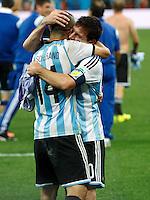 Lionel Messi of Argentina celebrates victory with Javier Mascherano