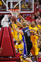 Mason Plumlee of the Blue Devils shoots against Terrapins' Cliff Tucker. Maryland defeated Duke 79-72 at the Comcast Center in College Park, MD on Wednesday, March 3, 2010. Alan P. Santos/DC Sports Box