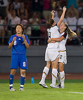 USWNT midfielder (9) Heather O'Reilly celebrates her goal with teammate (5) Heather Mitts as Japanese midfielder (8) Aya Miyama reacts to the play  while playing at Worker's Stadium.  The USWNT defeated Japan, 4-2, during the semi-finals of the Beijing 2008 Olympics in Beijing, China.