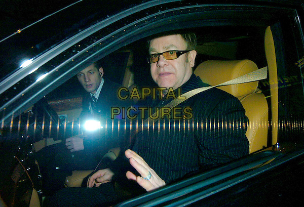 """ELTON JOHN.The """"A Guide To Recognizing Your Saints"""" screening at The Electric Cinema, London, UK..March 1st, 2007.half length black pinstripe suit sunglasses shades car.CAP/CAN.©Can Nguyen/Capital Pictures"""