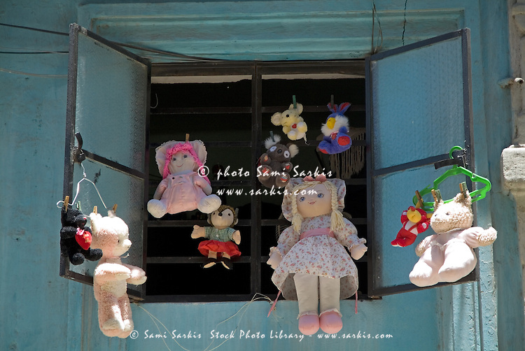 Soft toys hanging from a window on display, Havana, Cuba.